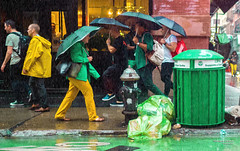 The New Yorkers - Colorful rainy day (François Escriva) Tags: street streetphotography us usa nyc ny new york people candid olympus omd photo rue light woman colors sidewalk manhattan umbrella green yellow men rain day rainy trash bin garbage can