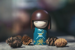 tranquil moment (rockinmonique) Tags: misaki meanstranquility back40 giftfromafriend kimmidoll pinecone macro toy bokeh light green red yellow orange moniquewphotography canon canont6s tamron tamron45mm copyright2019moniquewphotography
