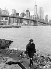 Brooklyn Shores (Anthony Mark Images) Tags: brooklyn newyork nyc bigapple brooklynshores rocks waves water eastriver newyorkskyline brooklynbridge janescarousel prettywoman asiangirl blackjeans blacktop dressedinblack hat smile people portrait nikon d850 flickrclickx