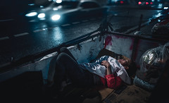 The Lonely Night (Camille Marotte) Tags: 2018 bangkok leica street streetphotography streets alone lonely woman old poor sleeping sleep city urban rain bokeh dark contrast darkness camillemarotte