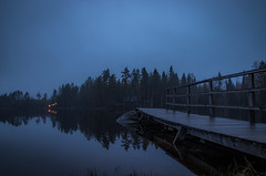 Rainy night II (mabuli90) Tags: finland lake forest tree dock pier cabin dark night blue rain woods water grass