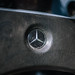 Mercedes star on the steering wheel of a vintage car