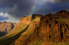 Rockface rainbow (snowyturner) Tags: canaries maspaloma mountains rocks landscape grancanaria rainbow clouds degollada viewpoint