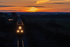 Sunset Eastbound (Going Trackside Photography) Tags: canadian national railway canada nova scotia new brunswick sunset sun set marsh tantramar silhouette