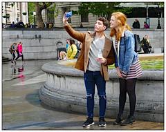Are we both in? (donbyatt) Tags: london trafalgarsquare street fashions people candid wet rain