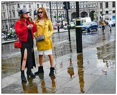 Showing a Leg (donbyatt) Tags: london trafalgarsquare street fashions people candid wet rain