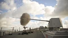 USS Roosevelt fires its Mark 45 Mod 2 5-inch gun.