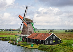 Windmills of Zaanse Schans (Brett of Binnshire) Tags: historicalsite zaandam netherlands manipulations river locationrecorded water on1raw architecture windmill clouds weather museum zaanseschans northholland
