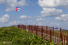 Boardwalk Cuba_MG_4969 (Alfred J. Lockwood Photography) Tags: alfredjlockwood travelphotography havana cuba boardwalk cubanflag clouds sky spring afternoon path