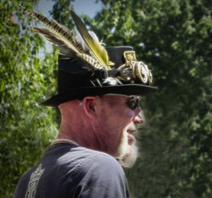 The Watchman (Jane Desforges) Tags: steampunk hat feathers beard contrast boost topazstudio