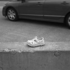 incident (kaumpphoto) Tags: rolleiflex 120 tlr ilford bw black white shoe concrete cement street urban city croc car tire hubcap door handle minneapolis barrier jerseybarrier crumble crack
