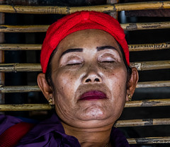 2019 - Cambodia - Sihanoukville - Ochheuteal Beach - 4 of 5 (Ted's photos - Returns late November) Tags: 2019 cambodia cropped nikon nikond750 nikonfx tedmcgrath tedsphotos vignetting sihanoukville sihanoukvillecambodia female woman napping asleep lips red redrule eyebrows earrings face candid 1people