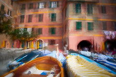 Vernazza (RCARCARCA) Tags: tourists photoartistry shutters people buildings photoshop canon washing 2470l trees blue pink fishingport topaz eosr sunshades vernazza fishingboats cinqueterre green yellow village boats italy