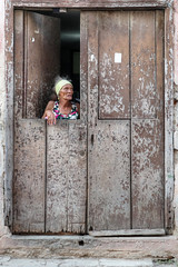 The lady at the door (FX-1988) Tags: lady street photography streetphotography woman door old havana cuba cuban people portrait latino poor home facade