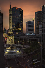 Indy Sunset (tylerjacobs) Tags: sony a6000 sigma 30 mm f14 long exposure car trails light gothic mile downtown city cityscape road intersection sign building indianapolis indiana hoosier indy