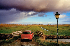 Zaanse (kunderwet) Tags: car landscape nederland goldenhour clouds village cloud 35mm film fujifilm analogue contax contaxg1 biogon