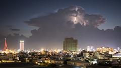 Da Nang 25 (arsamie) Tags: danang vietnam asia city town skyline building roof rooftop lightning thunder light sky storm cumulo nimbus bridge construction epic dramatic fury eclair bolt strike