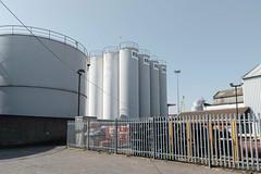 South Denes (John Pettigrew) Tags: lines tamron d750 ordinary industrial fences storage space mundane tanks imanoot banal shadows topographics documentary nikon angles documenting johnpettigrew silos