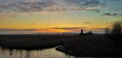 Daybreak (Peter ( phonepics only) Eijkman) Tags: zaandam zaanstad zaan zaanstreekwaterland waterland molen molens windmolen mill sun sunrise zonsopgang zon winter nederland netherlands nederlandse noordholland holland