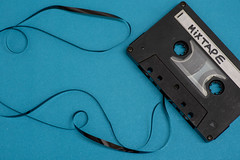 Cassette with mixtape written isolated against blue background (Rushay) Tags: technology retro cassette audio music mixtape tape portelizabeth southafrica
