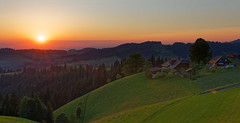 Emmental sunset (eichlera) Tags: sunset emmental switzerland dusk evening alps sky sun sunlight farmhouse hills forest