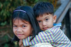 CAMBODIA194/ finally a  smile (Glenn Losack, M.D.) Tags: children cambodia siblings reap siam phnom penh asianchildren streetphotographer southeastasian sisterandbrother cambodianchildren siamreapchildren glosack