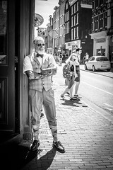 Cool dude (erikvdlinden) Tags: tranquility shoppingstreet old portraitphotography streetphotography adult blackwhite amsterdam man oneperson pedestrianstreet monochrome nederland relaxing alone afternoon street male waiting pavement beard bw noordholland nld countryhere
