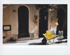 (Monica Forss) Tags: fujiinstax200wide film analog polaroid instant instax italy italia sicily sicilia cefalu door wheelbarrow street