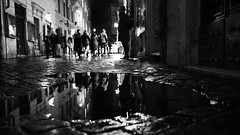 Rain makes the city brighter... (Michael Kalognomos) Tags: reflection woman rome italy rain road alley night lights bright monochrome bw blackwhite streetphotography streetlife mirror ef1635f4lisusm canoneos5dmarkiii urbanlandscape life