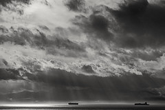 Towards the light (L@nce (ランス)) Tags: cloudy monochrome bw clouds storm sea pacific ocean salishsea olympics olympicmountains beautyofwater water reflection sunshine sunlight dramatic nikon victoria canada