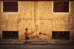 the goalkeeper - T8T_1407LaL32-1200w (tomas teneketzis) Tags: color yellow wall kid nikon play syria palmyra goalkeeper d300 tomasteneketzis teneketzis τενεκετζήσ θτενεκετζησ