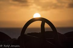 The sun setting into the sea (rjonsen) Tags: sunset horizon sea water sun clouds red sky evening light anchor winch maritime mariner sailor