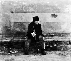 in the alley (Robert C. Abraham) Tags: canada atlanticcanada atlantic halifax halifaxnovascotia maritimes maritimeprovinces alley self selfportrait bw blackandwhite digital alleyway tarboosh walkingstick blackwhite wall stones stonewall seated resting winter brick tripodwork atmosphere 10secondselftimer selftimer