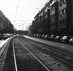 Going Back Home (DJ_Black_Tea) Tags: street cars bw a6000 sunset rails tram lines electricity houses