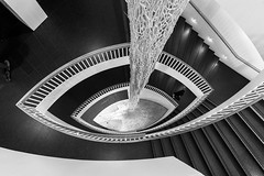 Down the Staircase (Karen_Chappell) Tags: stairs staircase stairway steps abstract fisheye canonef815mmf4lfisheyeusm wideangle bw blackandwhite travel chicago architecture building black white art interior museum gallery museumofcontemporaryart city urban usa illinois people geometry geometric railing