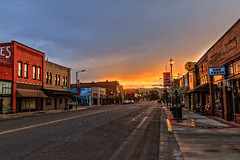 Main Street Sunrise (http://fineartamerica.com/profiles/robert-bales.ht) Tags: emmett forupload haybales idaho land people photo places projects states sunsetorsunrise emmetthistorical gemcounty sweet storm squawbutte farm landscape scenic idahophotography treasurevalley clouds emmettvalley trees thebutte canonshooter beautiful sensational awesome magnificent peaceful surreal sublime magical spiritual inspiring inspirational wow stupendous robertbales town butte emmettville historical buildings tomcahalan mainstreet sunrise sunset morning street