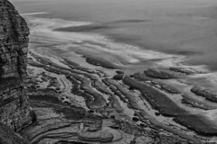 Dunraven Bay cliffs b&w (akatsoulis) Tags: valeofglamorgan southwales welshflickrcymru nikond5300 nikkor50mm14g manfrottobefree 10stopndfilter dunravenbay dunravencastle sea water cliffs wales blackandwhite