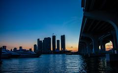 Miami Blue Time-9817 (islandfella) Tags: miami florida macarthur causeway skyline city downtown sunset duck silhouette skyscrapers water marine island gardens bridge sky boats luxury evening