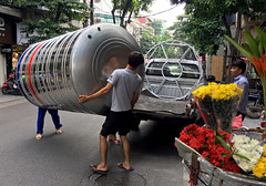 Water Tank Delivery (cowyeow) Tags: hanoi vietnam asia asian street urban city composition travel shop men working carry carrying big heavy watertank metal hardware candid people