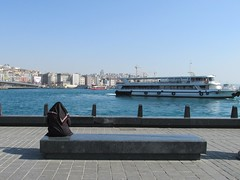 Looking out over the river (lazy south's travels) Tags: istanbul turkey turkish road street scene candid woman islam islamic niqab veil black modest sitting bench hijab conservative modesty alone boat ferry