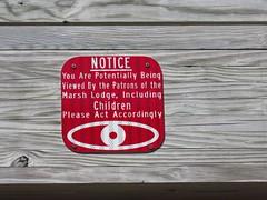 Smile! You're on Candid Camera! (jadedirishgryphon) Tags: sign advisory humor wisconsin marsh