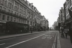 London (goodfella2459) Tags: nikonf4 afnikkor24mmf28dlens cinestillbwxx 35mm blackandwhite film analog london city streets buildings road bus pedestrians bwfp manilovefilm