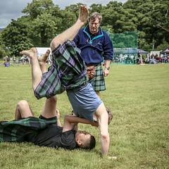 Wrestling Cartwheel (FotoFling Scotland) Tags: argyll event lochlomond scotland scottishwrestlingbond highlandgames kilt kilted luss lussgathering lusshighlandgames male wrestler wrestlingbond unitedkingdom