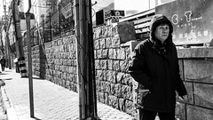 C.T. (Go-tea 郭天) Tags: qingdao shandong républiquepopulairedechine old lady woman cold winter sun sunny shadow walk walking sidewalk alone lonely cap covered lines wall pavement leaving portrait street urban city outside outdoor people candid bw bnw black white blackwhite blackandwhite monochrome naturallight natural light asia asian china chinese canon eos 100d 24mm prime