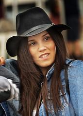 Portrait (D80_532063) (Itzick) Tags: telavivmar2019 candid color colorportrait streetphotography hat longhair youngwoman face facialexpression earrings d800 itzick
