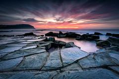 <cracked> up (< Nick Friend >) Tags: sunrise seascape water rocks ocean colour cloudslongexposure clouds fierysky sky forrestersbeach nsw australia