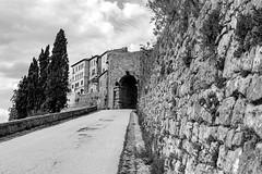 Esplorando Volterra 4 (Mancini photography) Tags: black white arch street monochrome rural etruscan wall