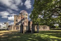 Atomic Bomb Dome Memorial Building - Hiroshima (Japan) (Andrea Moscato) Tags: andreamoscato giappone japan asia japanese 日本 nihon nippon asian light luce green shadow ombre prefecture attraction ombra site national nature natura natural naturale landscape paesaggio day sun sunshine white sky cielo view vivid vista scenic blue parco park trees history historic ancient wood art giardino branch building architecture monument tree edificio brilliant unesco world heritage sites peace memorial war sign structure heiwa kinenhi hall genbaku ruin afternoon memory field grass clouds nuvole città city