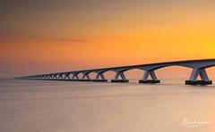 Zeelandbrug (Marc Haegeman Photography) Tags: zeelandbrug oosterschelde netherlands nederland zeeland brug sunrise glow orangehour longexposure marchaegemanphotography nikon landscapes