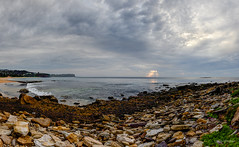 Light up the greys (JustAddVignette) Tags: australia beach clouds cloudy cloudysunrise headlands landscapes newsouthwales newport ocean panorama rockpool rocks sand seascape seawater sky sunrays sydney water